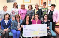 Parents Council present cheque to school at end of year ceremony